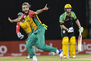 In this handout image provided by CPL T20, Imran Tahir (L) of Guyana Amazon Warriors appeals for lbw against Glenn Phillips (R) of Jamaica Tallawahs during match 29 of the Hero Caribbean Premier League match between Guyana Amazon Warriors and Jamaica Tallawahs at Guyana National Stadium on September 8, 2018 in Providence, Guyana.