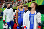 Louis Smith of Great Britain and teammates look on during the Artistic Gymnastics Men's Team qualification on Day 1 of the Rio 2016 Olympic Games at Rio Olympic Arena on August 6, 2016 in Rio de Janeiro, Brazil.