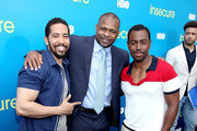 """(L-R) Neil Brown Jr, boxer Roy Jones Jr and Prentice Penny attend a block party celebrating HBO's new season of """"Insecure"""" on July 15, 2017 in Inglewood, California."""