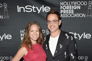 Actor Robert Downey Jr. and Susan Downey attend HFPA & InStyle's 2014 TIFF celebration during the 2014 Toronto International Film Festival at Windsor Arms Hotel on September 6, 2014 in Toronto, Canada.