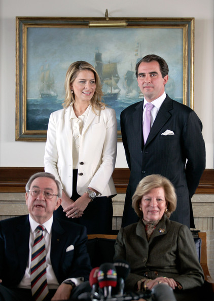Exiled King Constantine of Greece (FL) his  son Prince   Nikolaos of Greece (R) , Ms Tatiana Blatnik (L) and Queen  Anna-Maria   of Greece during a photo call with the press following their  engagement   at The Yacht Club of Greece on February 1, 2010 in Greece,  Athens.