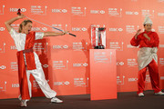 Suzann Pettersen of Norway and Inbee Park of South Korea strike a pose during a photocall at the Fairmont Hotel prior to the start of the 2014 HSBC Women's Champions on February 25, 2014 in Singapore, Singapore.