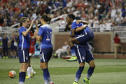 Crystal Dunn #25 of the United States jumps into the arms of Ali Krieger #11 of the United States after scoring a goal against Haiti as Heather O'Reilly #9 of the United States and Carli Lloyd #10 of the United States also celebrate the goal during the second half of the U.S. Women's 2015 World Cup victory tour match at Ford Field on September 17, 2015, in Detroit, Michigan. The US defeated Haiti 5-0.