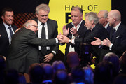 Uwe Seeler is congratulates by Lothar Matthaeus, Sepp Maier, Andreas Brehme, Franz Beckenbauer, Paul Breitner and Matthias Sammer on stage the Hall Of Fame gala at Deutsches Fussballmuseum on April 01, 2019 in Dortmund, Germany.