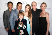 "(L-R) Actor Brian Tee, Actor Carlos Gomez, Actor Griffin Kane, Actress Ali Skovbye, Director Jay Russell, and Actress Anne Heche arrive at Hallmark Hall of Fame's ""One Christmas Eve"" Premiere Event at Fig & Olive Melrose Place on November 18, 2014 in West Hollywood, California."