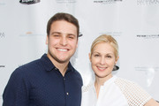 (L-R) Henry Hall and Kelly Rutherford attend Hamptons Magazine Celebration of The Children's Justice Campaign Of Joan & George Hornig on August 16, 2014 in Water Mill, New York.