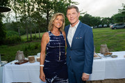 Gina Bradley and Bobby Flay attend the Hamptons Magazine Celebration with Cover Star Bobby Flay at Calissa on July 19, 2019 in Water Mill, New York.