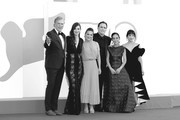 """This image has been converted in black and white) (L-R) Christopher McDonald, Rebecca Comerford, Nicole Ansari-Cox, Matt Dillon, Shirin Neshat and Sheila Vand attends the red carpet of the movie """"The Hand Of God"""" during the 78th Venice International Film Festival on September 02, 2021 in Venice, Italy."""