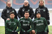 Thomas Schaaf, head coach of Hannover 96 poses for a photograph with new signings, (front row left to right) Hotaru Yamaguchi, Ádám Szalai and Iver Fossum during his first training session after the announcement  of his appointment on January 4, 2016 in Hanover, Germany.