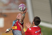 Mike Brown of Harlequins challenges for the ball with Clement Laporte of Agen during the European Rugby Challenge Cup match between Harlequins and Agen at Twickenham Stoop on October 13, 2018 in London, United Kingdom.