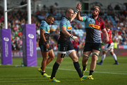 Mike Brown of Harlequins celebrates scoring his sides first try with James Chisholm during the European Rugby Challenge Cup match between Harlequins and Agen at Twickenham Stoop on October 13, 2018 in London, United Kingdom.