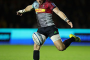 Mike Brown of Harlequins kicks the ball upfield during the Gallagher Premiership Rugby match between Harlequins and Saracens at Twickenham Stoop on October 6, 2018 in London, United Kingdom.