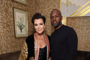 Kris Jenner and Corey Gamble pose for a photo as Harper's BAZAAR's Glenda Bailey celebrates her Damehood on May 05, 2019 in New York City.