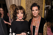 Joan Collins and Kris Jenner pose for a photo as Harper's BAZAAR's Glenda Bailey celebrates her Damehood on May 05, 2019 in New York City.