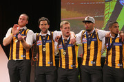Jarryd Roughead, Jordan Lewis, Sam Mitchell, Josh Gibson and Bradley Hill of the Hawks celebrate on stage during the Hawthorn Hawks AFL Grand Final post match function at Crown Palladium on September 28, 2013 in Melbourne, Australia.
