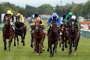 Adaay ridden by Paul Hanagan (blue and white cap) races clear to win The 888sport Sandy Lane Stakes at Haydock Racecourse on May 30, 2015 in Haydock, England.