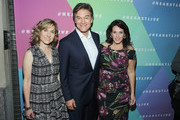 (L-R) Jill Herzig, Mehmet Oz and Lisa Oz attend the Hearst launch of HearstLive, a multimedia news installation, at 57th Street & 8th Avenue on September 27, 2016 in New York City.