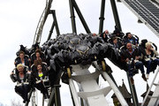 In the first row Claudia Effernberg, Lucia Effernberg, Christian Tews and Melanie Mueller and in the second row Lukas Sauer, Sabrina de Carvalho, Thomas Strunz and Manuel Cortez are pictured during the opening of the new wing coaster 'Flug der Daemonen' at Heidepark on March 20, 2014 in Soltau, Germany.