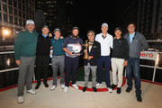 """(L-R) Thomas Bjorn of Denmark, Matt Wallace of England, Paul Dunne of Ireland, Andrew """"Beef"""" Johnston, Pawan Munjal, Chairman of Hero MotoCorp, Justin Rose of England, Thorbjorn Olesen of Denmark and MC Vernon Kay pose for a photo during the Hero Challenge at Canary Wharf on October 9, 2018 in London, England."""