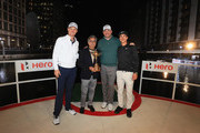 (L-R) Justin Rose of England, Pawan Munjal, Chairman of Hero MotoCorp, Thomas Bjorn of Denmark and Thorbjorn Olesen of Denmark pose for with the Ryder Cup trophy during the Hero Challenge at Canary Wharf on October 9, 2018 in London, England.