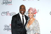 (L-R) Terry Crews and Rebecca King-Crews attend the Hilary Roberts Birthday Celebration and the Red Songbird Foundation Launch on May 11, 2019 in Los Angeles, California.