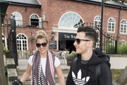 Gemma Atkinson and Gorka Marquez walk hand in hand as Gemma Atkinson, Gethin Jones and Dave Vitty from The Hits Radio celebrates the airing of their first show on June 4, 2018 in Manchester, England.