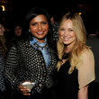 She smiles pretty with Mindy Kaling.
