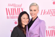 Producer Beth Kono (L) and actor-producer Charlize Theron attend The Hollywood Reporter's Power 100 Women in Entertainment at Milk Studios on December 11, 2019 in Hollywood, California.