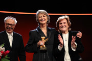 Charlotte Rampling (C) receives the Golden Bear from Festival director Dieter Kosslick (L) on stage next to Liliana Cavani (R) at the Homage Charlotte Rampling Honorary Golden Bear award ceremony during the 69th Berlinale International Film Festival Berlin at Berlinale Palace on February 14, 2019 in Berlin, Germany. Rampling is this years recipient of the Honorary Golden Bear Award of the Berlinale.