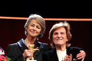 (L-R) Charlotte Rampling and Liliana Cavani are seen on stage at the Homage Charlotte Rampling Honorary Golden Bear award ceremony during the 69th Berlinale International Film Festival Berlin at Berlinale Palace on February 14, 2019 in Berlin, Germany. Rampling is this years recipient of the Honorary Golden Bear Award of the Berlinale.