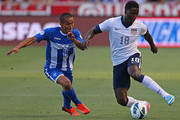Eddie Johnson #18 of the United States moves the ball past Andy Najar #19 of Honduras during the second half of a World Cup qualifying match on June 18, 2013 at Rio Tinto Stadium in Sandy, Utah.