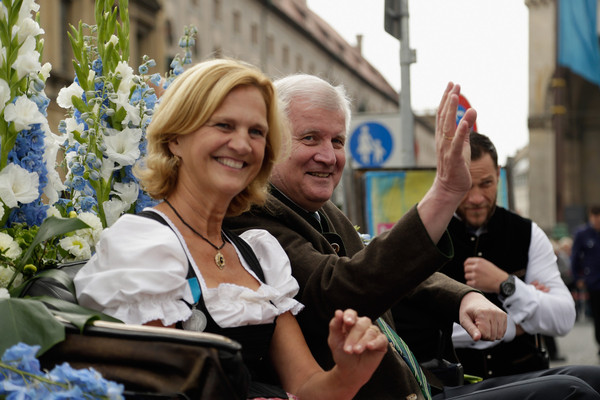 Oktoberfest 2015 - General Features Day 2 [event,smile,gesture,horst seehofer,karin seehofer,visitors,millions,riflemen,oktoberfest 2015,bavarian,trachten- und schuetzenzug,oktoberfest,parade of costumes]