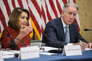 House Minority Leader Nancy Pelosi (D-CA) speaks as Rep. Richard Neal (D-MA) listens during a forum held by Democratic members of the House Ways and Means Committee discussing Republican tax legislation and the U.S. economy on December 13, 2017 in Washington, DC.