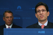 House Majority Leader Eric Cantor (R-VA) (R) speaks while flanked by  House Speaker John Boehner (R-OH) during a news conference at the U.S. Capitol June 10, 2014 in Washington, DC. Speaker Boehner and Leader Cantor spoke to the media after attending a closed meeting with House Republicans. In an unexpected upset, Cantor was later defeated by Tea Party challenger David Brat in Virginia's congressional primary.