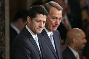 Newly sworn-in Speaker of the House Paul Ryan (L) (R-WI) stands with outgoing Speaker of the House John Boehner (R) (R-OH) after Ryan's election to the leadership position October 29, 2015 in Washington, DC. The House elected Ryan (R-WI) as the 62nd Speaker of the House.