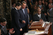 Newly sworn-in Speaker of the House Paul Ryan (L) (R-WI) waves to colleagues while standing with outgoing Speaker of the House John Boehner (R) (R-OH) after Ryan's election to the leadership position October 29, 2015 in Washington, DC. The House elected Ryan (R-WI) as the 62nd Speaker of the House.