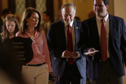U.S. Rep. Steve King (R-IA) (2nd R) and Rep. Michele Bachmann (R-MN) (3rd R) pass through the Statuary Hall after a vote on the floor August 1, 2014 on Capitol Hill in Washington, DC. The House came back on Friday, a day after its scheduled summer recess, trying to finish up a border supplemental spending bill that was pulled from the floor the day before because of a shortage of votes.
