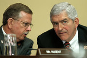 Rep. Daniel Webster (R-FL) (R) and Rep. Richard Nugent (R-FL) (L) confer while constitutional lawyers testify at a House Rules Committee hearing July 16, 2014 at the U.S. Capitol in Washington, DC. The committee heard testimony on Speaker of the House John Boehner's lawsuit against President Obama's use of executive power and providing for the authority to initiate litigation for actions by the President inconsistent with his duties under the Constitution of the United States