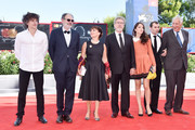 Yann Tregoue, Jean-Pierre Darroussin, Ariane Ascaride, Robert Guediguian, Anais Demoustie,  Robinson Stevenin and Jacques Boudet walk the red carpet ahead of the 'The House By The Sea (La Villa)' screening during the 74th Venice Film Festival at Sala Grande on September 3, 2017 in Venice, Italy.