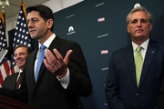 U.S. Speaker of the House Rep. Paul Ryan (R-WI) (2nd L) speaks as House Majority Leader Rep. Kevin McCarthy (R-CA) (R) and Rep. Neal Dunn (R-FL) (L) listen during a news briefing after a House Republican Conference meeting at the Capitol December 19, 2017 in Washington, DC. The House is expected to vote on the tax bill this afternoon.