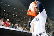 Jean Segura #2 of the Seattle Mariners waits to dump Robinson Cano #22 of the Seattle Mariners with a Gatorade bath after hitting a three run home run to win the game 7-4 in the eighth inning against the Houston Astros during their game at Safeco Field on August 20, 2018 in Seattle, Washington.