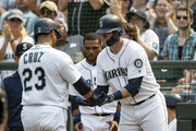 Nelson Cruz #23 of the Seattle Mariners is congratulated by Ryon Healy #27 of the Seattle Mariners after hitting a solo home run off of starting pitcher Charlie Morton #50 of the Houston Astros during the fourth inning of a game at Safeco Field on August 22, 2018 in Seattle, Washington.