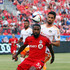 Robbie Findley Photos - Robbie Findley #55 of Toronto FC battles for the ball with Jermaine Taylor #4 of the Houston Dynamo during an MLS soccer game at BMO Field on May 10, 2015 in Toronto, Ontario, Canada. - Houston Dynamo v Toronto FC