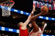 James Harden #13 of the Houston Rockets draws a foul as he drives against Alex Len #25 of the Atlanta Hawks in the first half at State Farm Arena on January 08, 2020 in Atlanta, Georgia.  NOTE TO USER: User expressly acknowledges and agrees that, by downloading and/or using this photograph, user is consenting to the terms and conditions of the Getty Images License Agreement.