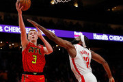 Kevin Huerter #3 of the Atlanta Hawks attempts a shot as he drives against James Harden #13 of the Houston Rockets in the second half at State Farm Arena on January 08, 2020 in Atlanta, Georgia.  NOTE TO USER: User expressly acknowledges and agrees that, by downloading and/or using this photograph, user is consenting to the terms and conditions of the Getty Images License Agreement.
