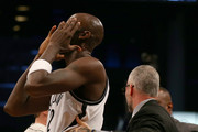 Kevin Garnett #2 of the Brooklyn Nets reacts as he is pulled away from Dwight Howard of the Houston Rockets at the Barclays Center on January 12, 2015 in the Brooklyn borough of New York City. NOTE TO USER: User expressly acknowledges and agrees that, by downloading and/or using this photograph, user is consenting to the terms and conditions of the Getty Images License Agreement.