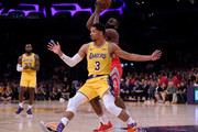 James Harden #13 of the Houston Rockets keeps the ball from Josh Hart #3 of the Los Angeles Lakers during a 124-115 Rockets win at Staples Center on October 20, 2018 in Los Angeles, California.