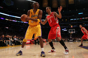Kobe Bryant #24 of the Los Angeles Lakers looks to move the ball against Courtney Lee #5 of the Houston Rockets during their opening night game at Staples Center on October 26, 2010 in Los Angeles, California. NOTE TO USER: User expressly acknowledges and agrees that, by downloading and or using this photograph, User is consenting to the terms and conditions of the Getty Images License Agreement.