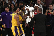 Brandon Ingram #14 of the Los Angeles Lakers is held back by Lonzo Ball #2 as he has words with Carmelo Anthony #7 of the Houston Rockets during the second half of a basketball game at Staples Center on October 20, 2018 in Los Angeles, California. NOTE TO USER: User expressly acknowledges and agrees that, by downloading and or using this photograph, User is consenting to the terms and conditions of the Getty Images License Agreement.