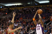 Michael Redd #22 of the Phoenix Suns attempts a three point shot against the Houston Rockets during the NBA game at US Airways Center on February 9, 2012 in Phoenix, Arizona. The Rockets defeated the Suns 96-89. NOTE TO USER: User expressly acknowledges and agrees that, by downloading and or using this photograph, User is consenting to the terms and conditions of the Getty Images License Agreement.